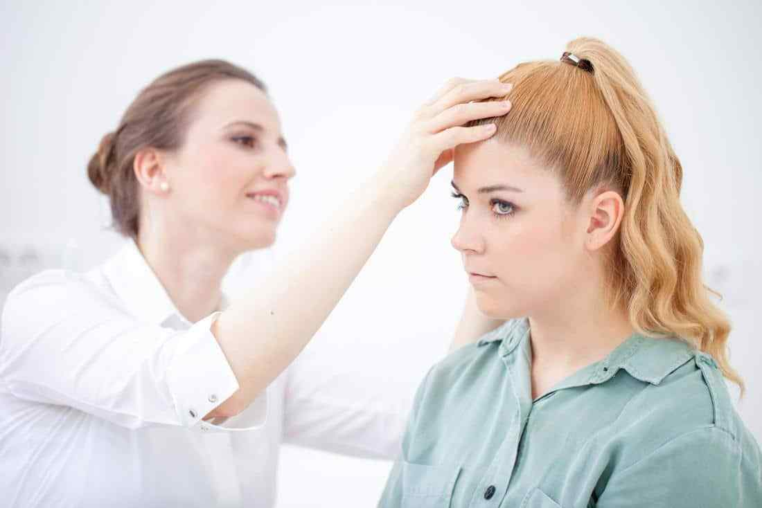doctor-inspecting-a-patients-scalp-for-dandruff-or-dry-scalp.jpg